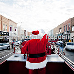 "Santa waves from a vintage Princeton Fire Department truck during the Christmas parade down Main St. in Princeton, Illinois, U.S., on Saturday, Dec. 3, 2011. Photographer:  Daniel Acker<br /> <br />  <a href=""http://www.danielacker.com"">http://www.danielacker.com</a><br /> 815-303-7814<br /> dan_acker@yahoo.com"